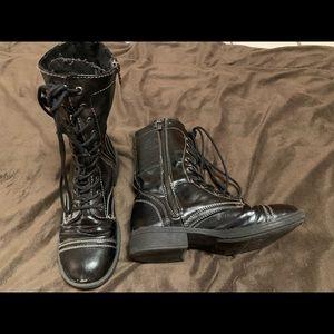 Black combat boots with zipper
